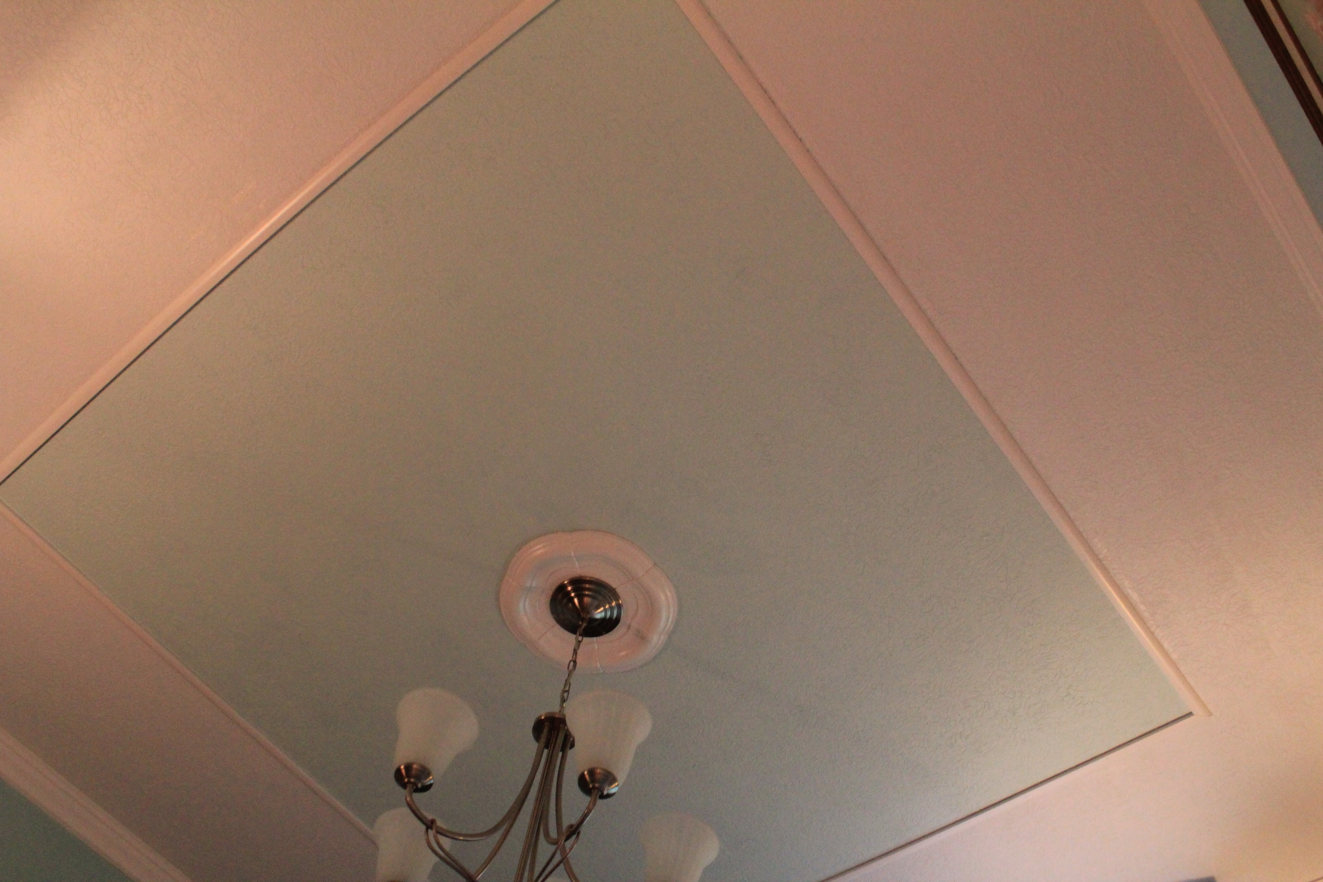 how to create a faux tray ceiling and give your room character