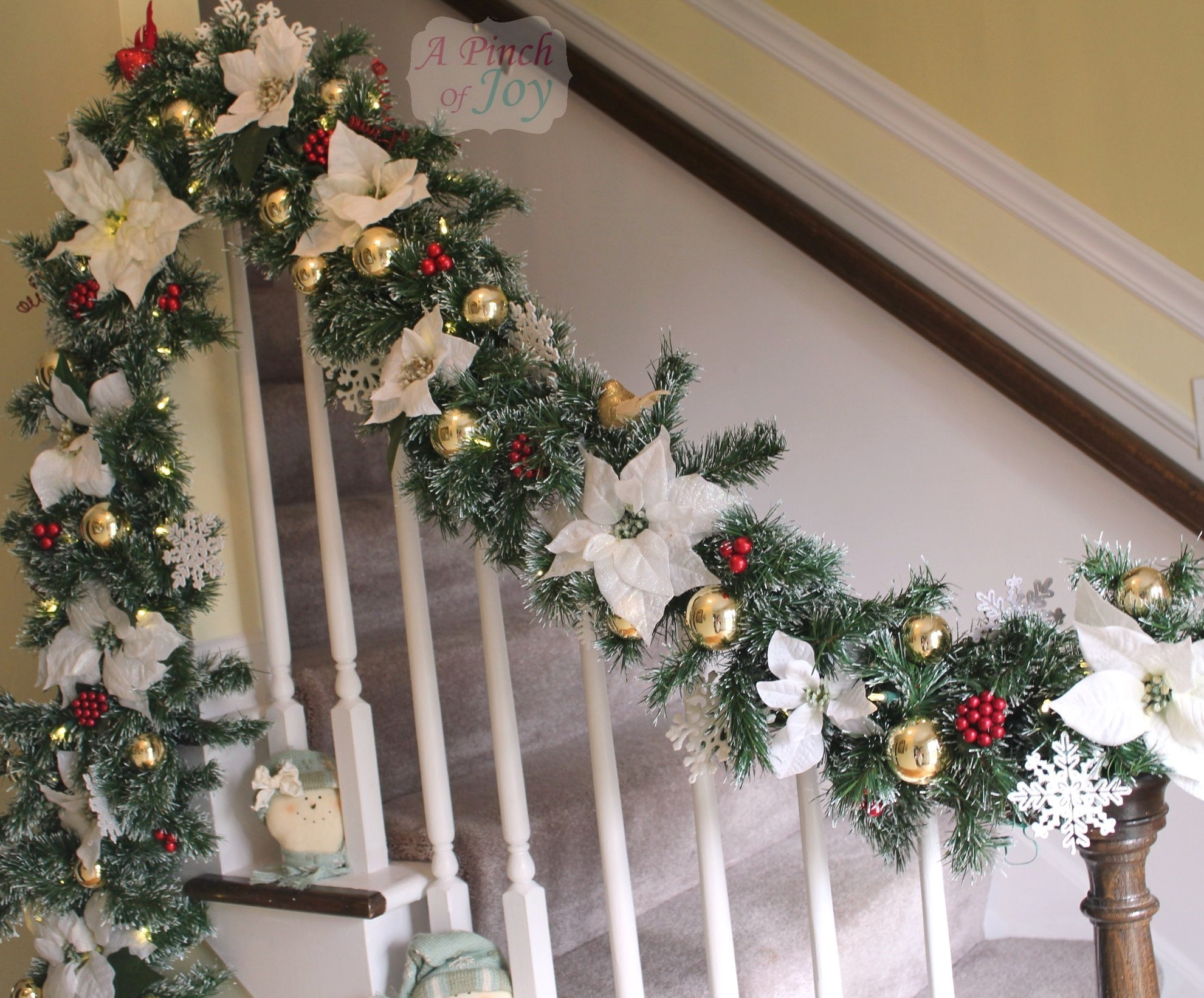 we changed the colors in the hallway so i made a new garland to go with the new scheme i used the classic white gold and red colors and the white - Banister Christmas Garland Decor