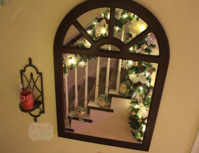 Banister garland relfected in mirror