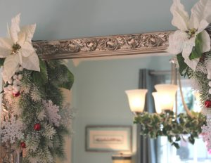 Corner swags and chandelier decoration reflected in mirror -- Christmas throughout the house A Pinch of Joy