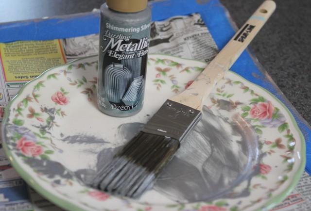 Paint on a plate with brush and paint bottle