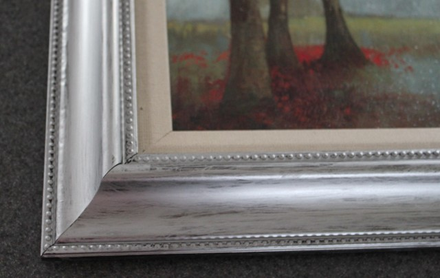 Corner of picture frame painted silver
