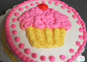 Chocolate Torte frosted with buttercream and decorated with cupcake