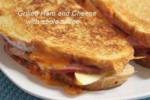 Grilled ham and cheese sandwich with apple