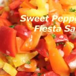 Orange, red, yellow sweet pepper salad
