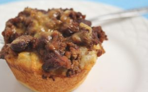 Chili and ground beef in a biscuit cup