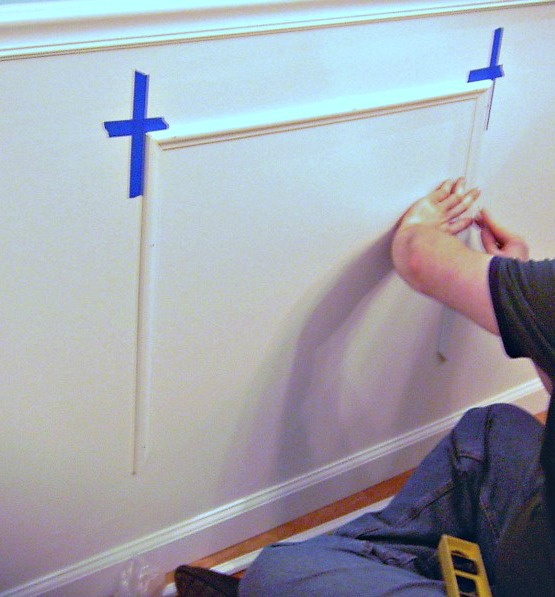 Applying the third side of the picture frame moulding