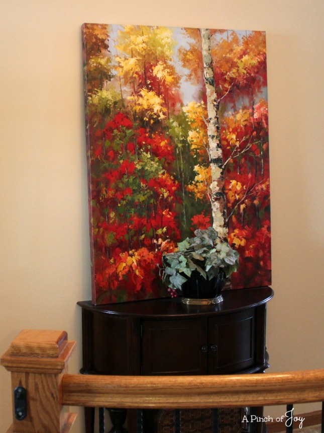 The new demilune table in the hallway