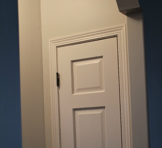 Linen Closet Door painted creamy white