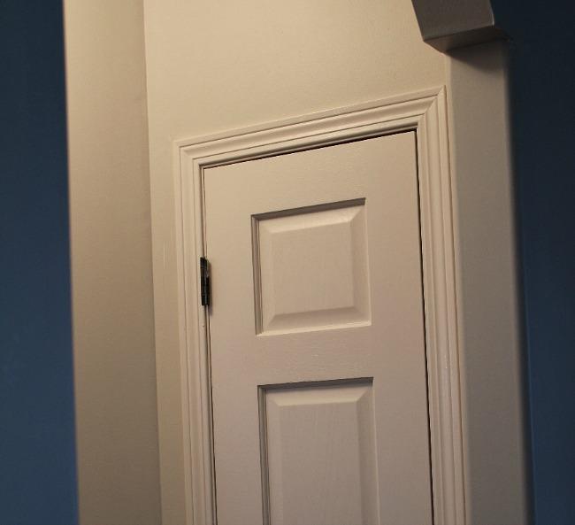 Linen Closet Door painted creamy white