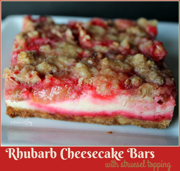 Rhubarb Cheesecake Bars -- A Pinch of Joy Sweet tangy rhubarb on a cheesecake with a nutty crust and struesel topping