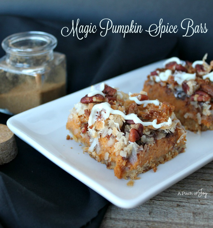 Magic Pumpkin Spice Bars -- A Pinch of Joy  A fall favorite atop a vanilla wafer crust and garnished with coconut, pecans and white chocolate.  Yum