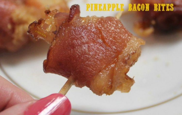 Pineapple Bacon Bites - A Pinch of Joy Sugared bacon wrapped around pineapple bits, baked to perfection!