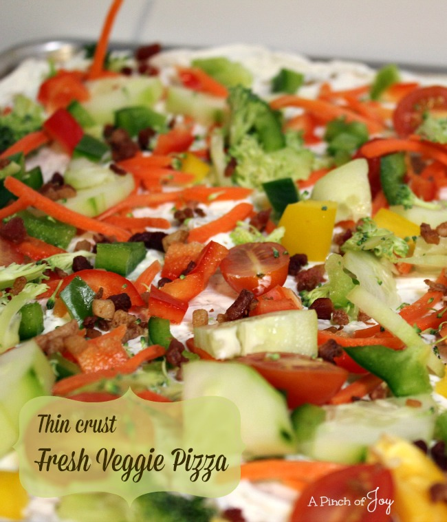 Thin-Crust-Fresh-Veggie-Pizza-A-Pinch-of-Joy Fresh vegetables atop crispy crust and creamy base provide a burst of color and nutrition for your appetizer table!