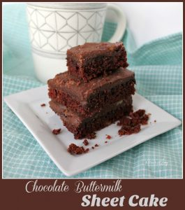 .Chocolate Buttermilk Sheet Cake -- A Pinch of Joy #QuickEasy Dense moist cake with the slight tang of buttermilk topped with fudgy rich frosting. Ready in 30 minutes.